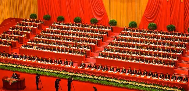 The Central Committee of the Chinese Communist Party in the Great Hall of the People, uniformed in identical suits, red ties, and side-parts.
