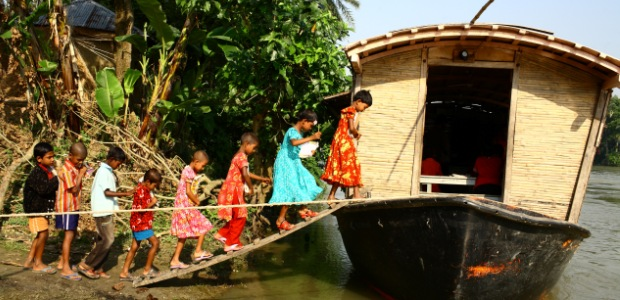 Children go to school on boat in flood-prone Bangladesh. Photo: G.M.B Akash/Panos