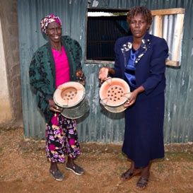 Helida Ouka (left) and Eunice Omondi (right) show off the 'Uhai stove'