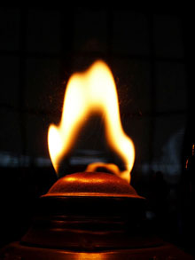 Closeup of the flame of an oil lamp