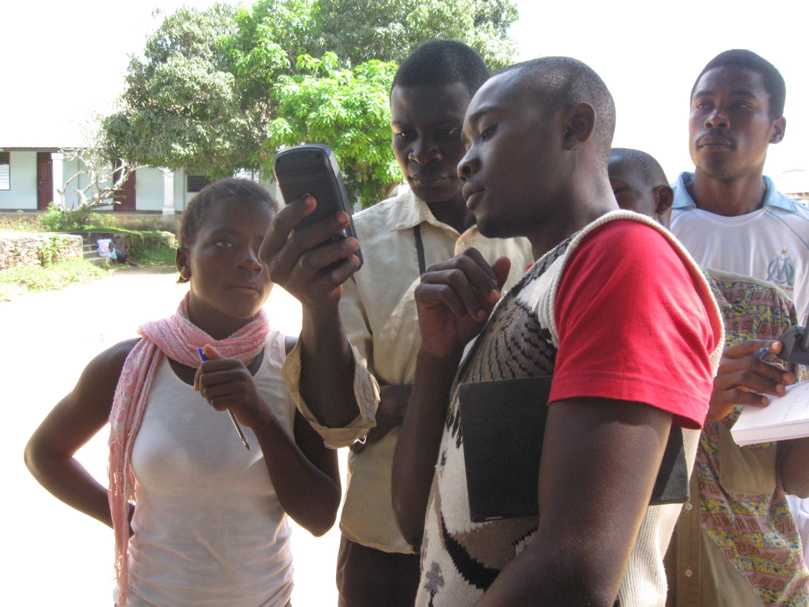 Young people in Okola, Cameroon learn how to use GPS units to create community maps