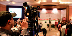 Filming CBA8 conference on community-based adaptation to climate change. Photo by Stephanie Andrei
