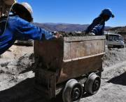 Miners pushing a cart out of a mine near the Bolivian town of Potosi. For centuries this area had the richest silver mines in South America. Today many of the mines are worked by local cooperatives, but conditions are still harsh (Photo Nyall & Maryanne, Creative Commons via Flickr)