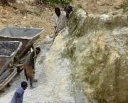 Small-scale miners dig soil mining for tin in Rwanda.