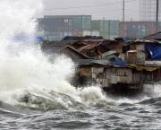 A typhoon hits shanties in Manila. Urban governments, which are already struggling to provide basic infrastructure services, also need to build resilience to climate change (Photo: Ernie Penaredondo/Global Water Partnership, Creative Commons via Flickr)
