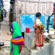 Women in Dhaka, Bangladesh queue to get access to a raised tube well; local indicators about access to water are essential for the SDGs (Photo: Development Planning Unit, UCL, Creative Commons, via Flickr)