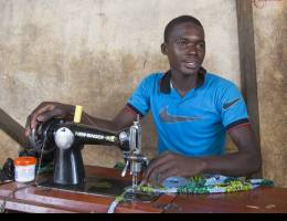 Moussa Samgare, 18, is a tailor who also owns a plot of irrigated land. He works in the field every morning from 7am, then goes to his shop and works there until 6pm (Photo: Mike Goldwater/GWI)