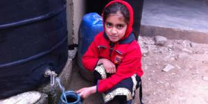A girl in Pakistan collects rainwater for washing (Photo: Fawad Khan)