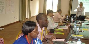 Project partners share their experiences during a global learning network meeting in Uganda. Photo: Bill Vorley