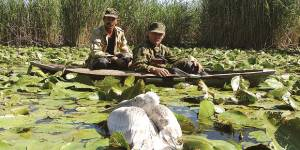 Protected area guards encounter a pelican. Photo: UNDP