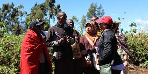 A Maasai elder educates CBA9 participants on the issues he has as part of a woodlot afforestation project (Photo: Matt Wright/IIED)