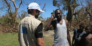 A satellite phone provided by Télécoms Sans Frontières, with European Commission funding, enables a man from Tanna island to finally talk to loved ones ten days after communications were cut off by Cyclone Pam in March 2015 (Photo: TSF, Creative Commons, via Flickr)