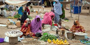 An image of women selling produce in an internally displaced persons camp, near Tawilla in North Darfur. The 'leave no one behind' agenda aims to ensure the poor are included in sustainable development (Photo: UNAMID, Creative Commons via Flickr)