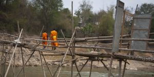 Monks crossing a bridge in the Lao People's Democratic Republic. Poor infrastructure and rural poverty make this LDC nation highly vulnerable to climate change impacts (Photo: DFAT, Creative Commons via Flickr)