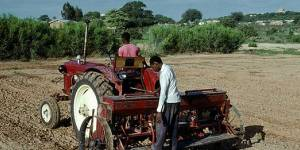 Mechanised farming in Tanzania. Land purchases by foreign investment companies for agribusinesses are pushing farmers off their land. Using legal rights effectively can help local people get a better deal for themselves and their communities (Photo: Africa Renewal)