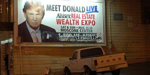 """A poster advertises Donald Trump's appearance at a """"Wealth Expo"""" (Photo: Steve Rhodes, Creative Commons via Flickr)"""