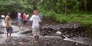 Vanuatu is one of the Least Developed Countries, and is increasingly affected by climate change. Here local people are constructing a river crossing using rocks and coral after flooding destroyed a bridge (Photo: 350.org, Creative Commons via Flickr)