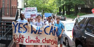 Climate activists march to the entrance of Georgetown University before President Obama's speech on climate change. Photo: 350.org via Flickr
