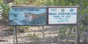 Signs welcome visitors to the Sunderban Tiger Reserve in India. Wandering tigers still kill humans in the region, but this reserve generates employment and ecosystem benefits and other income for local people (Rick Hobson, Creative Commons via Flickr)