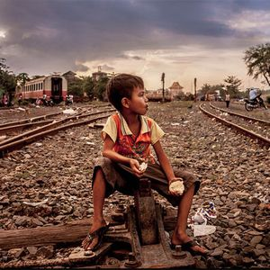 An image of a boy sitting on a train track. The aspiration of the SDGs is that no one will be left behind (Photo: Zoriah, Creative Commons, via Flickr)