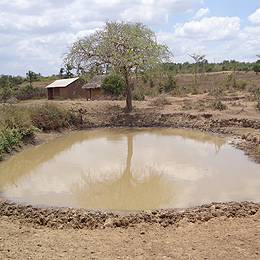 Digging livestock water pans in homesteads to increase livestock production: an innovation of Duruma community, Kenya (Photo: Stella Mutta)
