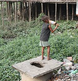 A child playing near a toilet in Bangladesh in 2009 (Photo: Diana Mitlin)