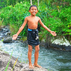 An Indonesian child in a community-managed forest (Photo: Plan Vivo Foundation)