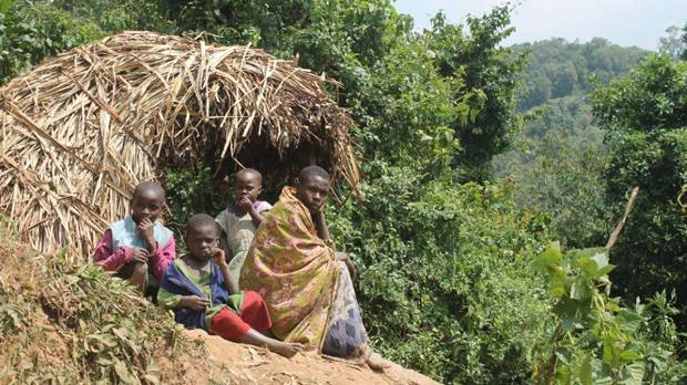 A family guards their crops from wild animals on the boundary of Bwindi Impenetrable National Park (Photo: Mariel Harrison)