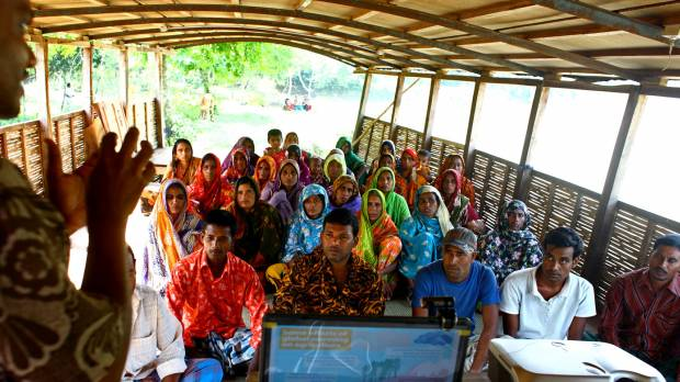 A group meeting on climate change on boat run by the organisation Shidhulai in Natore, Bangladesh (Photo: Tony Stonehouse/IIED)