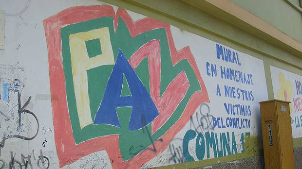 """""""Paz"""" (peace) graffiti in Medellín, Colombia. The text to the right translates as """"Mural in tribute to our victims of conflict"""" (Photo: Cathy McIlwaine)"""