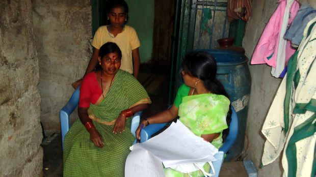 Surveying residents in low-income housing in Vijinapura, India. Receiving accurate data about slums can help local authorities plan solutions (Photo: cstepin, Creative Commons via Flickr)
