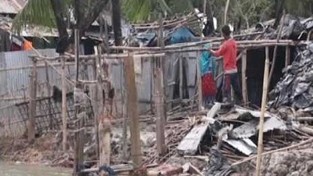 An image of television footage of a man standing instead a destroyed house after Cyclone Roanu hit Bangaldesh (Photo: Google licence)