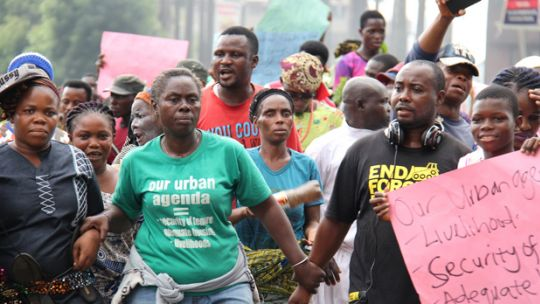 Bimbo Osobe and Samuel Akinrolabu, members of the Nigerian Slum/Informal Settlement Federation, lead a march of residents of Lagos waterfront communities threatened with eviction, to Governor Akinwunmi Ambode's office to demand open dialogue with the government on alternatives to evictions of the urban poor (Photo: Andrew Maki)