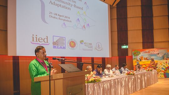 An image of Saleemul Huq at the podium giving a speech. On the final day of the CBA10 conference, he called for federations and communities of the urban poor to be better utilised by urban developers, climate change practitioners and local government to mainstream local adaptation (Photo: ICCCAD, Creative Commons, via Flickr)