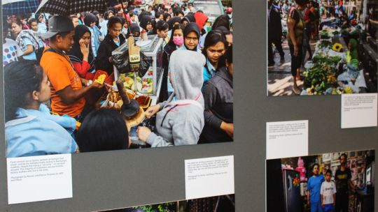 A photo of the images on display in an exhibition of informal economy livelihoods at the conference (Photo: Matt Wright/IIED)