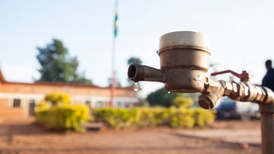 A water tap in Rwanda. Measuring sustainability of investments in water and sanitation makes more sense than focusing on annual freshwater withdrawal and access to improved water and sanitation (Photo: A'Melody Lee/World Bank, Creative Commons, via Flickr)