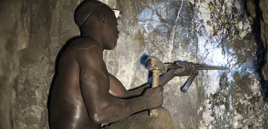 Fortunatus Waziri, a driller, works deep within a tunnel at the Nsangano Gold Mine, Mawemeru village in Geita District, Tanzania (Photo: Brian Sokol/Panos Pictures)