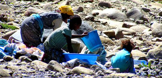 Three girls wash their clothes in the Akaki river, near Addis Ababa. Climate change is affecting the quality of water in Ethiopia and much of the wastewater released by the industries and houses in Addis Ababa reaches the Awash River untreated, putting public health at risk (Photo: Beatrice Mosello/ODI, Creative Commons, via Flickr)