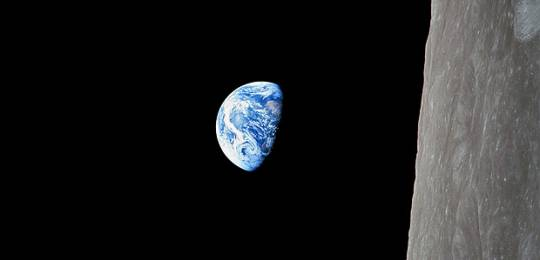 The first photograph taken of Earthrise by Apollo 8 in December 1968. The Apollo Programme to Combat Climate Change proposes large-scale public investment and determined political effort from powerful states to take down carbon energy sources (Photo: NASA/woodleywonderworks, Flickr, via Creative Commons)