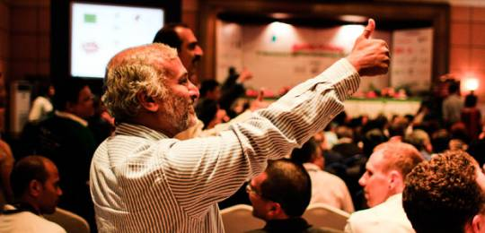 A delegate at CBA8 gives the thumbs up to views expressed during a session (Photo: Stephanie Andrei)