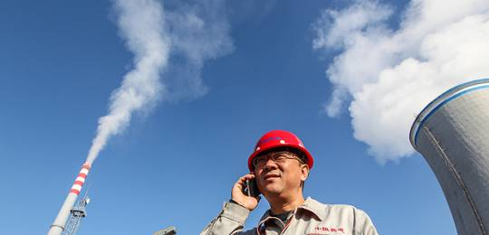 Wang Zhi, assistant production manager of Jiamusi Zhongheng Thermoelectric Ltd, which was built in 1999 to provide 1.75 million GJ annually for Dalkia with an annual coal consumption of 350,000 tons (Photo: Asian Development Bank, Creative Commons, via Flickr)