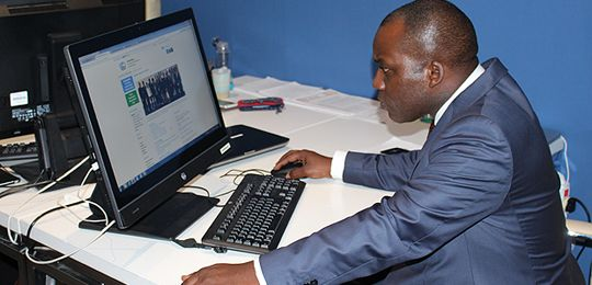 The Least Developed Countries Group chair, Giza Gaspar Martins, studies the new draft COP21 intently after it was published on Wednesday afternoon (Image: Matt Wright/IIED)