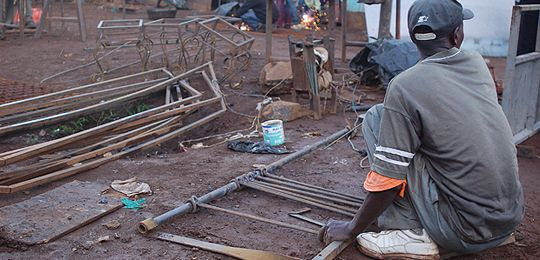 A welder uses home-made equpiment in Kenya, where the Jua Kali (informal economy) thrives and can solve any problem (Photo: Erik (HASH) Hersman, Creative Commons, via Flickr)
