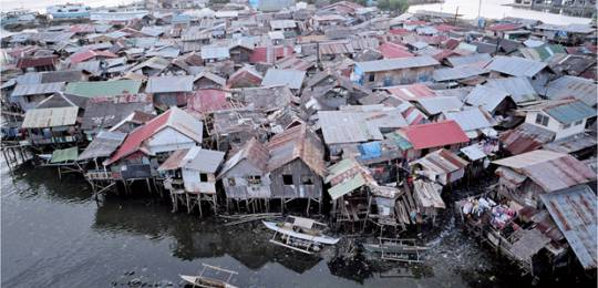 The Multidimensional Poverty Index only has one indicator to assess housing quality – whether floors are made of dirt, sand or dung. So these houses in Manila would not be classified as sub-standard (Photo: Mark Edwards/IIED)