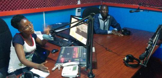 ON AIR: a local farmer joins a broadcaster in the studio of KRC.FM (Photo: Matt Wright/IIED)