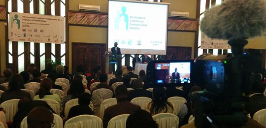 A camera focuses on events at CBA9, in Kenya. International audiences will be able to follow CBA10 from afar through a range of online channels (Image: Matt Wright/IIED)