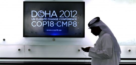 A delegate at COP18 in Doha  (Photo:  N. Palmer/CIAT, Creative Commons via Flickr)