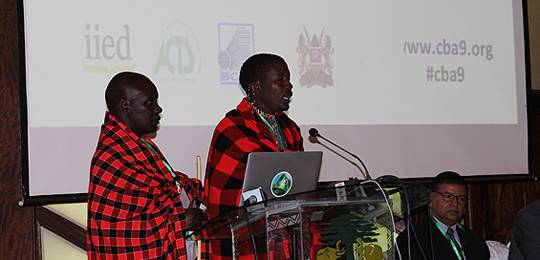 Salaton Ole Ntutu, a Maasai cultural leader, and Stephen Ole Kisotu, of the Medungi project, address delegates at CBA9 in April 2015 (Photo: Matt Wright/IIED)