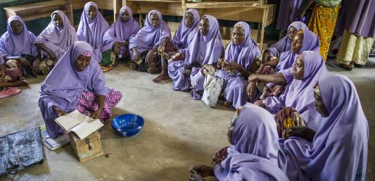 A women's savings club in Nigeria allows women to borrow money for medical expenses or business initiatives. Financially empowering women is an important step in eradicating extreme poverty (Photo: Karen Kasmauski, USAID Maternal and Child Health Integrated Program)