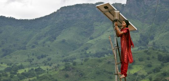 Maintaining the solar street lighting in the village of Tinginaput, India. SDG 7 calls for access to affordable, reliable, sustainable and modern energy for all (Photo: UK Department for international Development Creative Commons via Flickr)